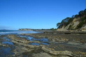 Walk around the rocks to Long bay